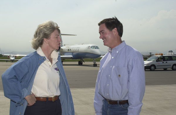 Secretary Gale Norton, left, with Colorado Governor Bill Owens at airport media session during visit to central Colorado for assessment, with federal,state, and local officials, of the Hayman forest fire emergency. Fire, started southwest of Denver, is the largest in Colorado's recorded history, affecting90,000 acres and prompting Interior ban on all public uses of federal lands in five counties