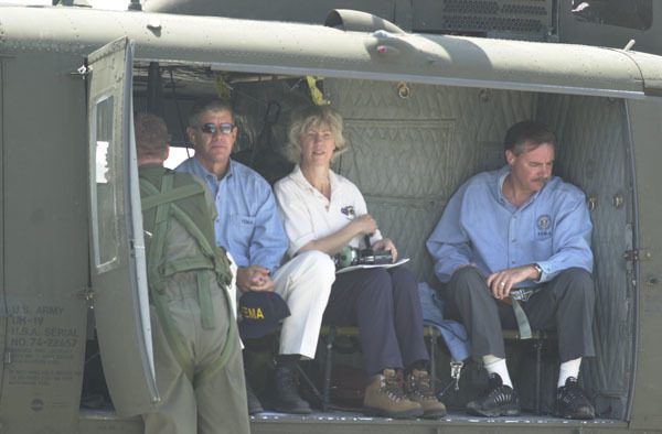 Secretary Gale Norton, third from left, seated in helicopter with Federal Emergency Management Agency personnel during visit to central Colorado for assessment, with federal, state, and local officials, of the Hayman forest fire emergency. Fire, started southwest of Denver, is the largest in Colorado's recorded history, affecting 90,000 acres, including portions of the Pike and San Isabel National Forests