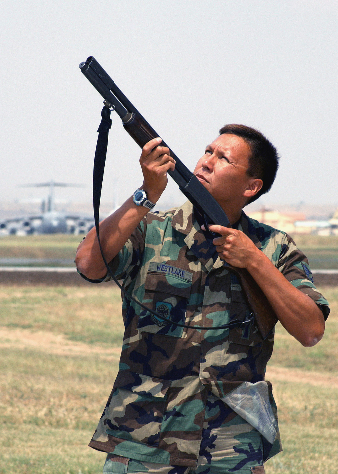 US Air Force Reserve (USAFR) STAFF Sergeant (SSGT) Jerry Westlake, 39th Operations Support Squadron (OSS) use a Remington 870 12-gague shotgun loaded with pyrotechnical shells (blanks) as a last resort to scare off unwanted birds in flight, while conducting the Bird and Strike Hazard (BASH) program at Incirlik Air Base (AB), Turkey