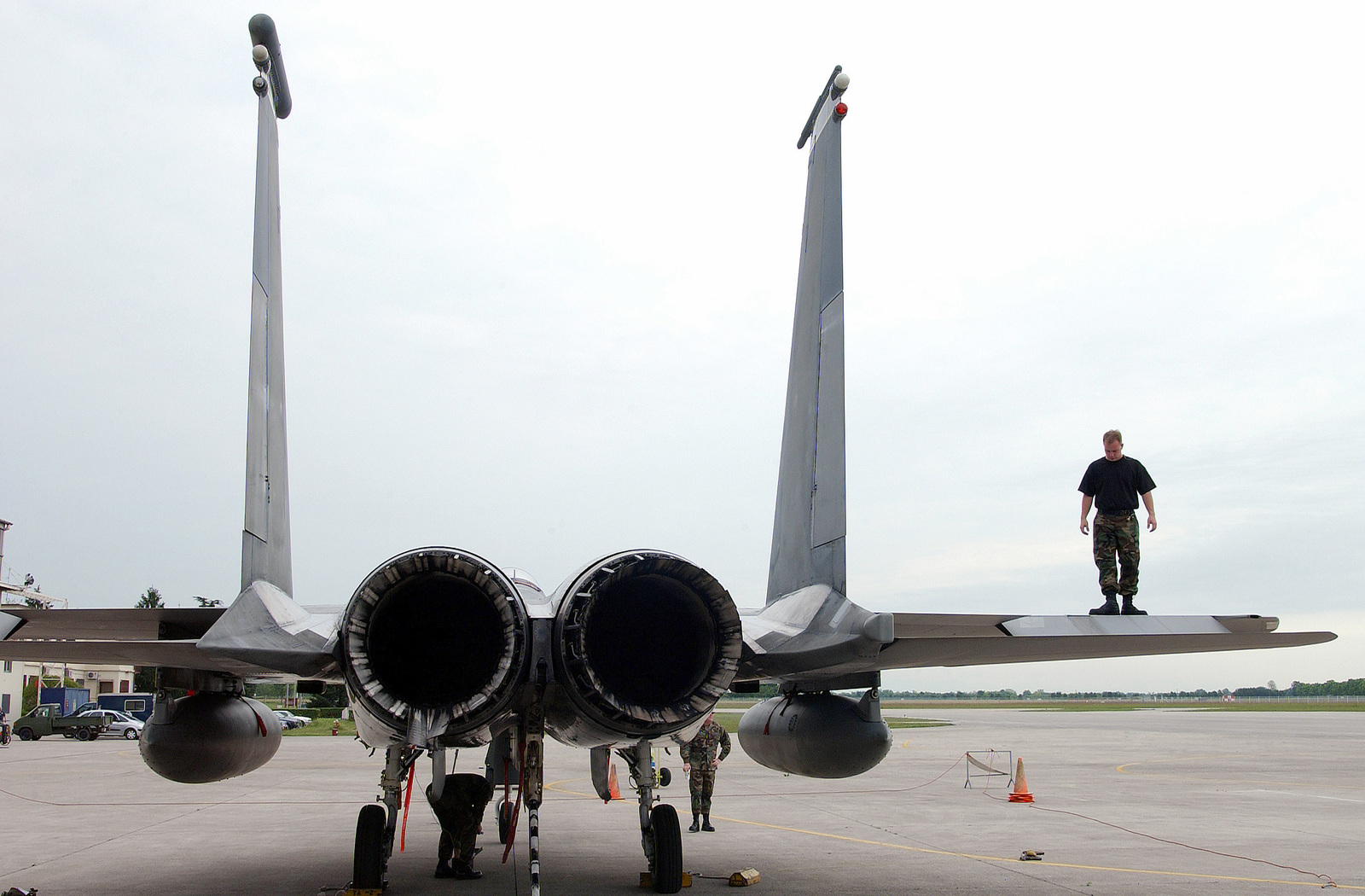 US Air Force (USAF) personnel assigned to the 493rd Fighter Squadron (FS), perform a post flight inspection of a F-15C Eagle aircraft on the flight line at Aviano Air Base (AB), Italy. The aircraft experienced mechanical problems with the landing gear causing an emergency landing at Aviano Air Base on its way from an air show in Bratislava, Slovakia