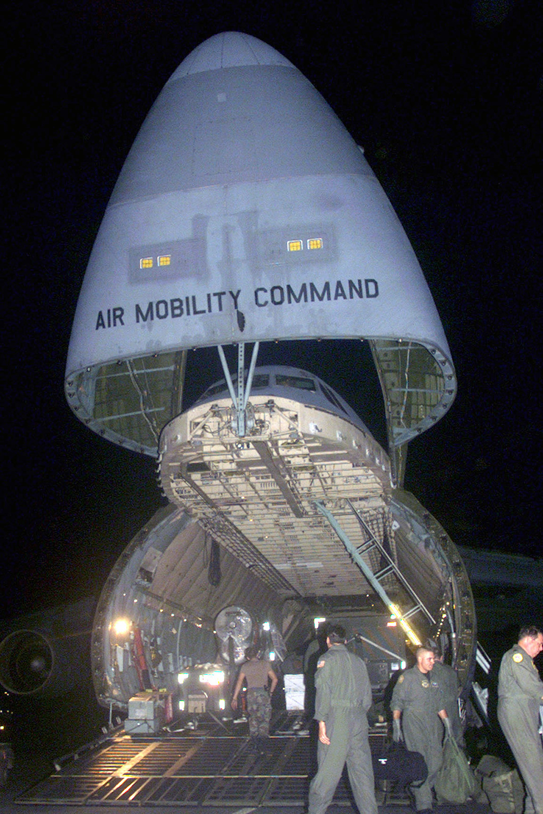 A US Air Force (USAF), Air Mobility Command (AMC), C-5A Galaxy aircraft is offloaded on the flight line at Moron Air Base (AB), Spain, during Operation ENDURING FREEDOM