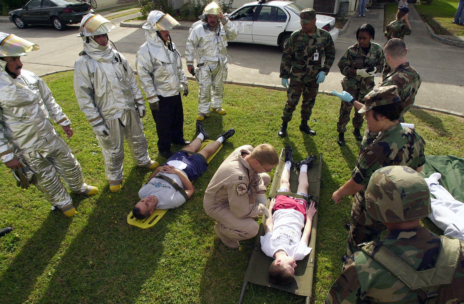 Civilian Firefighters and US Air Force (USAF) Medical personnel attend to a simulated earthquake victim during a natural disaster mass casualty exercise conducted at Incirlik Air Base (AB), Turkey