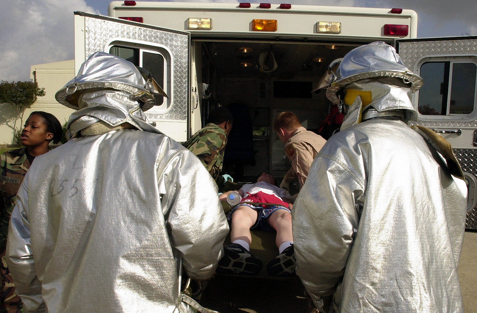 Civilian Firefighters and US Air Force (USAF) Medical personnel load a simulated earthquake victim into an ambulance, during a natural disaster mass casualty exercise conducted at Incirlik Air Base (AB), Turkey