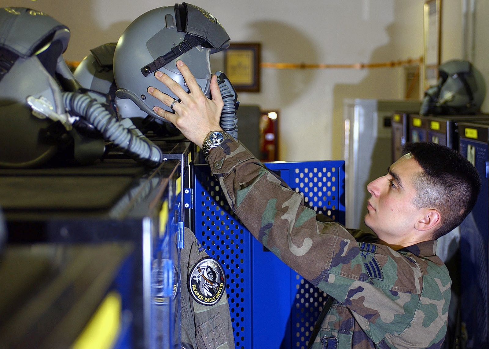 US Air Force (USAF) SENIOR AIRMAN (SRA) Jorge Chavez, Life Support Floor Supervisor, 493rd Fighter Squadron (FS), 48th Fighter Wing (FW), does post flight inspections on life support equipment inside the life support section at Royal Air Force (RAF) Lakenheath, United Kingdom (UK)