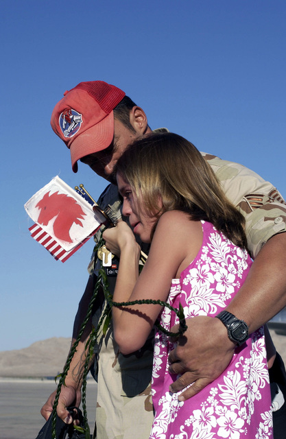 US Air Force (USAF) Technical Sergeant (TSGT) Gerry Aguiar, 820th Red Horse Squadron (RHS), embraces his emotional daughter, Jessica Aguiar, on the flight line at Nellis Air Force Base (AFB), Nevada, after returning home following a six-month deployment in support of Operation ENDURING FREEDOM