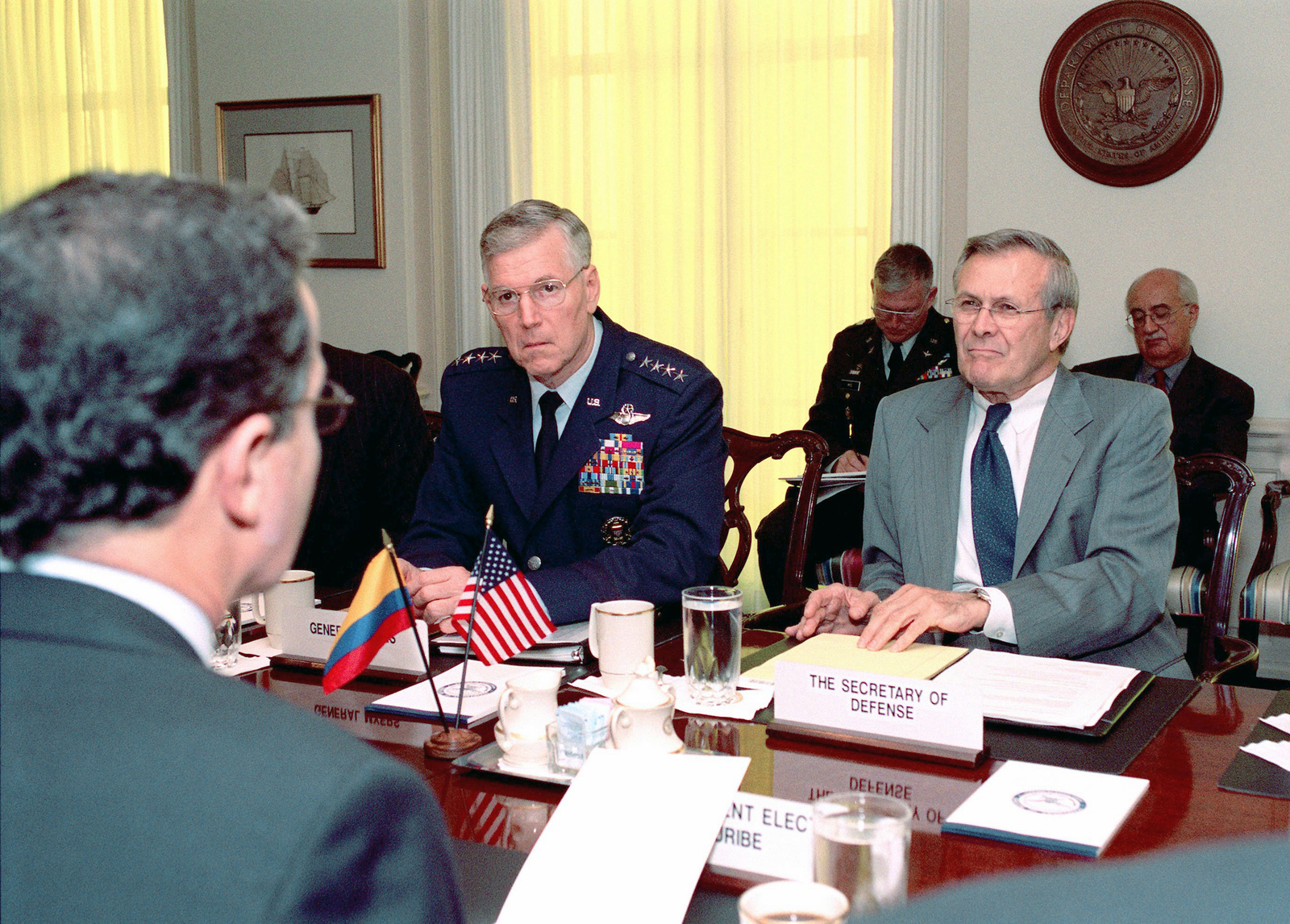 US Air Force (USAF) General (GEN) Richard B. Myers (left) Chairman of the Joint Chiefs of STAFF, and US Secretary of Defense, The Honorable Donald H. Rumsfeld, meet with Republic of Columbia, President-elect Alvaro Uribe, (foreground) during a defense meeting held at the Pentagon in Washington, District of Columbia (DC)
