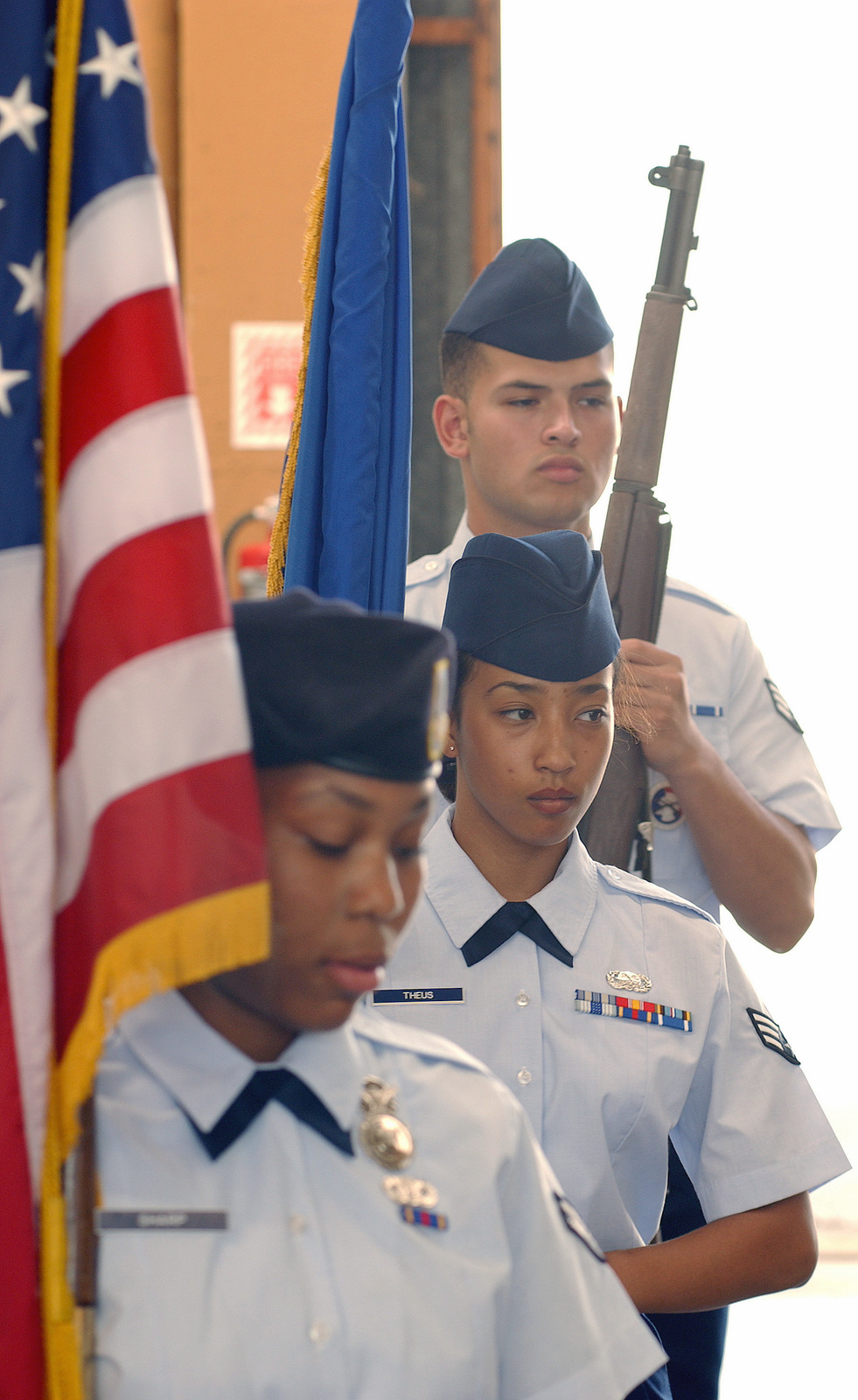 US Air Force (USAF) Airmen assigned to the 31st Fighter Wing (FW), Honor Guard Team practice posting the Colors during a drill practice held at Aviano Air Base (AB), Italy. Pictured are AIRMAN First Class (A1C) Candace Sharp (foreground), 31st Security Forces Squadron (SFS), SENIOR AIRMAN (SRA) On Theus (center), 31st Supply Squadron, and SRA Luis Flores, 555th Fighter Squadron (FS)