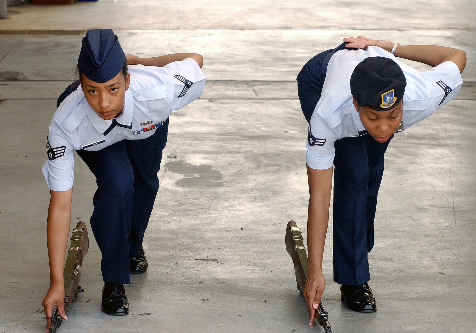 US Air Force (USAF) SENIOR AIRMAN (SRA) On Theus (left), 31st Supply Squadron and USAF AIRMAN First Class (A1C) Candace Sharp, 31st Security Forces Squadron (SFS), both members of the Honor Guard Team, participate in a rifle drill practice held at Aviano Air Base (AB), Italy