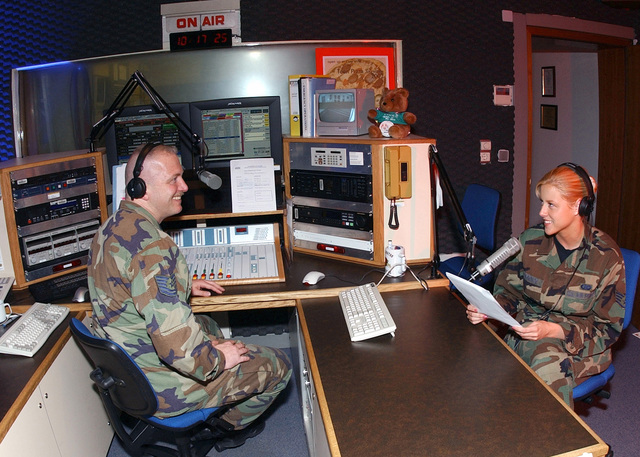 US Air Force (USAF) Technical Sergeant (TSGT) Mike Burnette (left), Non-Commissioned Officer In Charge (NOCIC), Armed Forces Network (AFN) Radio, and USAF STAFF Sergeant (SSGT) April Lawrence, News Department, NOCIC, both assigned at Kaiserslautern, Germany, conduct a live broadcast for Kaiserslautern Military Community (KMC) members on the new Z 100.2 radio program. The AFN Kaiserslautern branch made new programming changes to better serve the KMC, by going to a 12-hour a day live, local broadcasting schedule