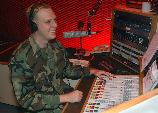 US Army (USA) Sergeant (SGT) Mark Howell, a Radio Broadcaster with Armed Forces Network (AFN), Kaiserslautern, Germany, talks to Kaiserslautern Military Community (KMC) members on the new Z 100.2 radio program. The AFN Kaiserslautern branch made new programming changes to better serve the KMC by going to a 12-hour a day live, local broadcasting schedule