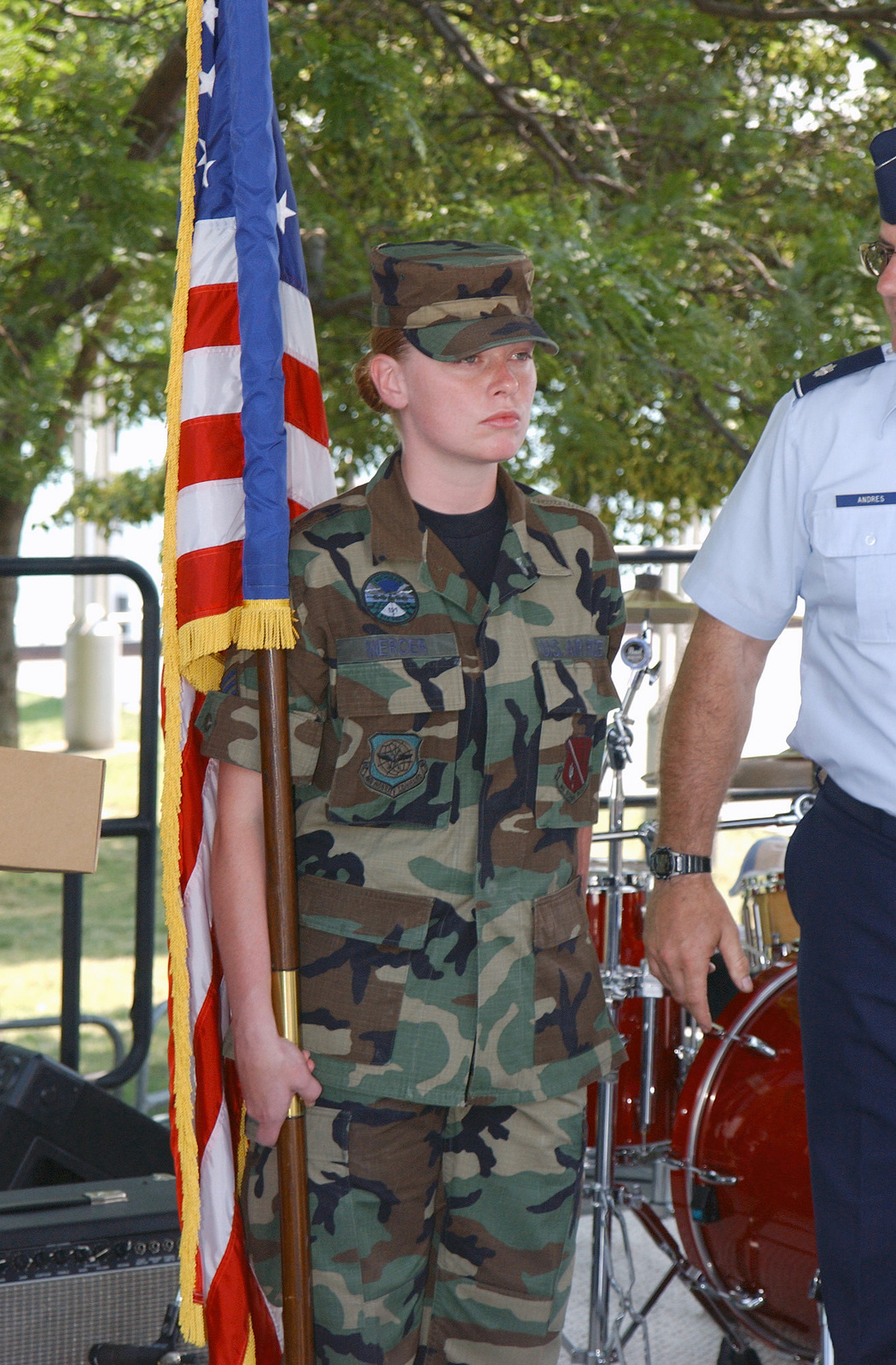 US Air Force (USAF) STAFF Sergeant (SSGT) Melissa Mercer, (left) an Electrician assigned to the 191st Maintenance Squadron (MXS), performs the duties of the Color Sergeant during a Swearing in Ceremony being held at Hart Plaza, Detroit, Michigan (MI)