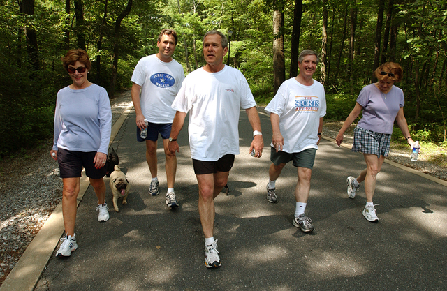President George W. Bush, First Lady Laura Bush, Marvin Bush, Andy Card and Kathleene Card Walk at Camp David