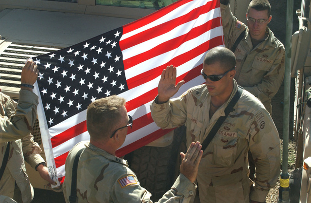 US Army (USA) Sergeant (SGT) Brian D. Jones (center), assigned to D/Company, 3/505th Infantry, 82nd Airborne Division, is administered the Oath of Enlistment, by USA Captain (CPT) Mark Landis, Commander, D/Company, during a Reenlistment Ceremony conducted at DaRaud, Afghanistan, during Operation ENDURING FREEDOM. SGT Jones an infantryman reenlisted for an additional 5 years