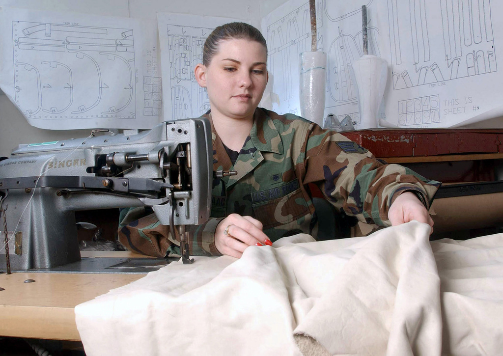 US Air Force (USAF) SENIOR AIRMAN (SRA) Amanda Thomason-Isaac, Orthotics Technician, 374th Medical Group, uses a sewing machine to sew back and leg straps made from a leather fabric. The orthotics lab makes braces and devices for the treatment of orthopedic disorders