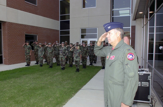 US Air Force (USAF) Colonel (COL) Robert Ireton, Commander, 138th Fighter Wing (FW) salutes during the Flag Raising Ceremony conducted in front of the new Headquarters and Support Complex Building for the 138th FW, located at Tulsa International Airport, Tulsa, OK