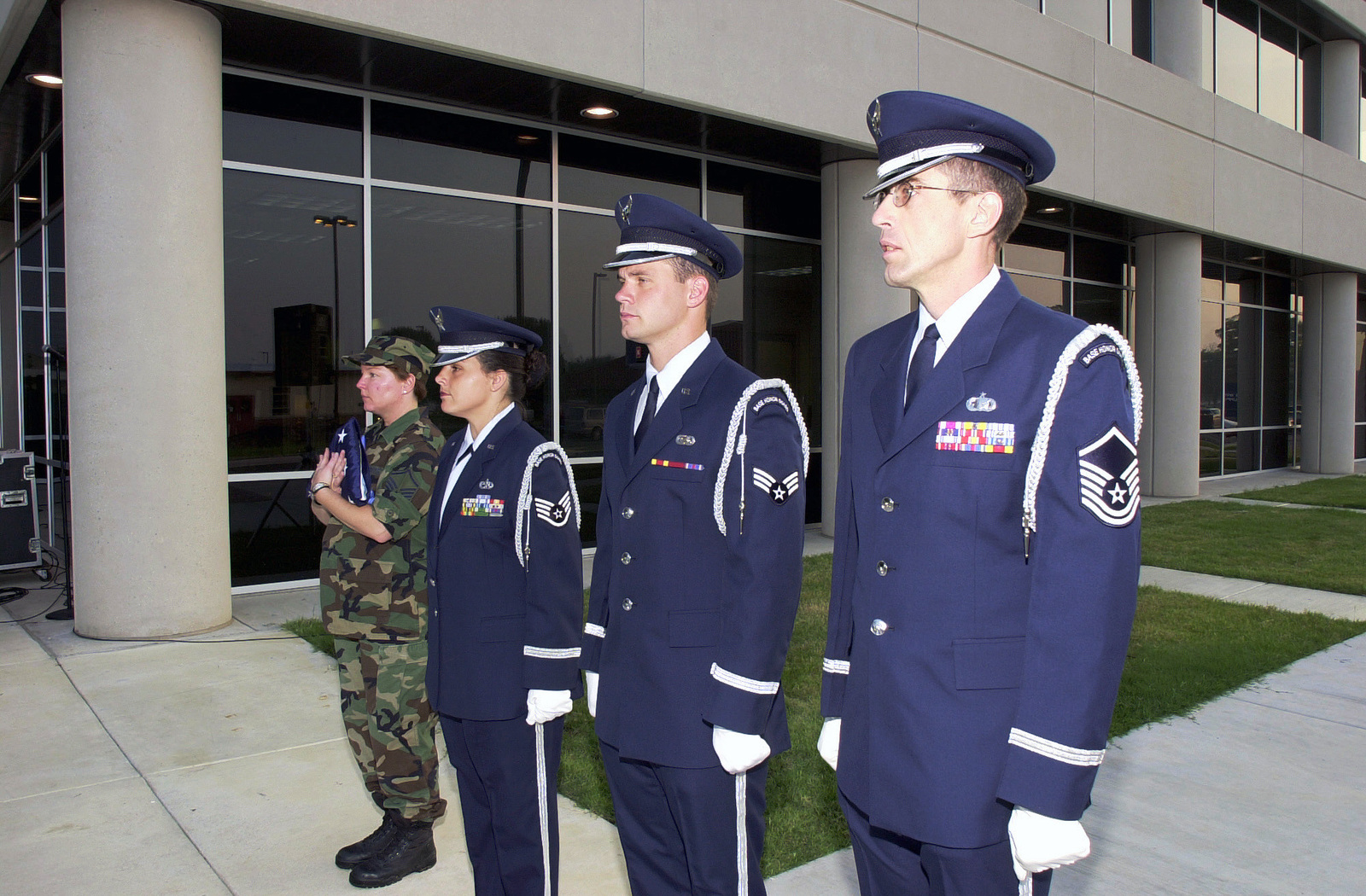 US Air Force (USAF) personnel assigned to the 138th Fighter Wing (FW), Oklahoma (OK), Air National Guard (ANG) Honor Guard, stand ready to raise the base flag in front of the new Headquarters and Support Complex Building for the 138th FW, Tulsa, International Airport (IAP), located in Tulsa, OK
