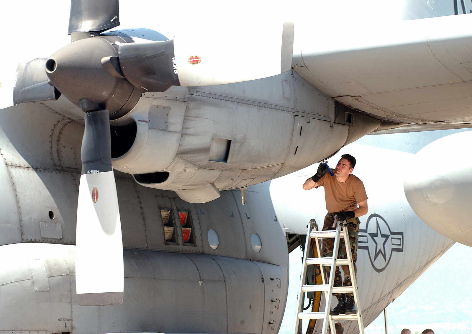 US Air Force (USAF) Technical Sergeant (TSGT) George Nunn, 37th Airlift Wing (AW) performs an intake and exhaust inspection on a USAF C-130 Hercules aircraft on the flight line at Aviano Air Base (AB), Italy
