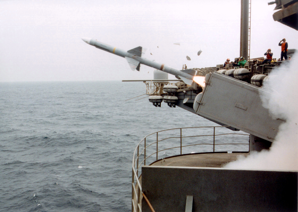 A North Atlantic Treaty Organization (NATO) RIM-7M Sea Sparrow radar-guided, air-to-air missile is fired from the Mk 29 Guided Missile Launching System (GMLS) onboard the US Navy (USN) Aircraft Carrier USS JOHN F. KENNEDY (CV 67) during a missile exercise. The Kennedy Battle Group and her embarked Carrier Air Wing Seven (CVW-7) are on a regularly scheduled deployment conducting missions in support of Operation ENDURING FREEDOM