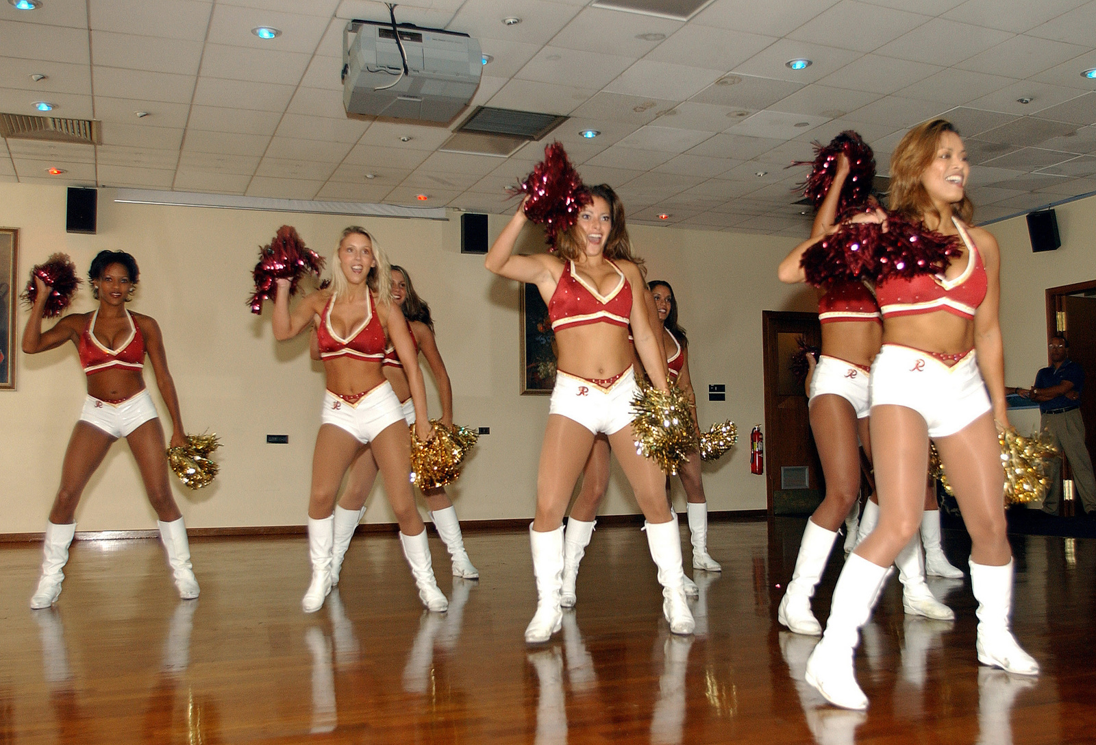 Members of the Cheerleading Squad from the National Football League (NFL) Washington Redskins Football Team perform for US Air Force (USAF) personnel inside the Non-Commissioned Officers (NCO) Base Club at Aviano Air Base (AB), Italy. The squad is on a promotional tour throughout Europe to various bases to entertain troops and promote morale