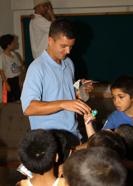 US Air Force (USAF) SENIOR AIRMAN (SRA) Rob Malcolm, passes out toys to Turkish children at an orphanage in Mersin, Turkey. SRA Malcolm is deployed to Incirlik Air Base (AFB), Turkey, from Rickenbacker Air National Guard Base (ANGB), Ohio (OH), in support of Operation NORTHERN WATCH