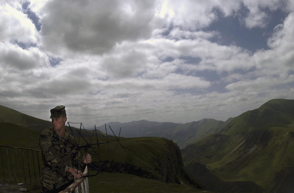US Army (USA) Captain (CPT) Sean Williams, assigned to the 10th Special Forces Group (SFG) (Airborne), sets up an AN/PSC-5 satellite communications radio, on a Russian landmark high in the Caucus Mountains, located in Tabilis, Georgia, while attending the Georgian Train and Equip Program (GTEP). GTEP conducted by the US Army European Command, is designed to enhance the capability of selected Georgian military units to provide security and stability to the citizens of Georgia and the region