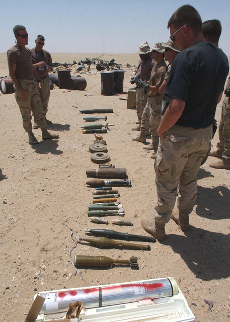 An assortment of ammunition, fuses, grenades, mines and projectiles are placed on display as a multi-national group of military Explosive Ordnance Disposal (EOD) experts train at the Udairi Range, located in Camp Doha, Kuwait. Because each service has its own requirements and mission types, joint training helps to expand different units' capabilities and familiarization with techniques