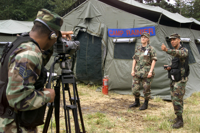 US Air Force (USAF) STAFF Sergeant (SSGT) Jerome Turner (left) and Technical Sergeant (TSGT) Mario Muncey (right), both assigned to the 4th Combat Camera Squadron (CCS), prepare to conduct a videotaped terview with USAF Colonel (COL) Martha Stowe, Exercise Commander, at Camp Raier, McChord Air Force Base (AFB), Washgton (WA), prior to the start of Exercise SEAHAWK 2002. Seahawk combes active duty and reserve components from the US Air Force (USAF), US Navy (USN), US Coast Guard (USCG), US Public Health Service, Royal Canadian Armed Forces (RCAF), Federal Bureau of Investigation (FBI), Federal Emergence Management Association (FEMA) and multiple civilian first responder agencies...