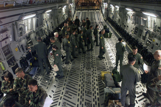 Medical emergency response teams from various branches of the US Military familiarize themselves with the layout inside the cargo compartment of a USAF C-17A Globemaster III aircraft in preparation for training in support of Exercise SEAHAWK 2002. Seahawk combines active duty and reserve components from the US Air Force (USAF), US Navy (USN), US Coast Guard (USCG), US Public Health Service, Royal Canadian Armed Forces (RCAF), Federal Bureau of Investigation (FBI), Federal Emergence Management Association (FEMA) and multiple civilian first responder agencies in coordinated responses to simulated terrorist acts inside the Continental United States (CONUS) and outside (OCONUS) environments....