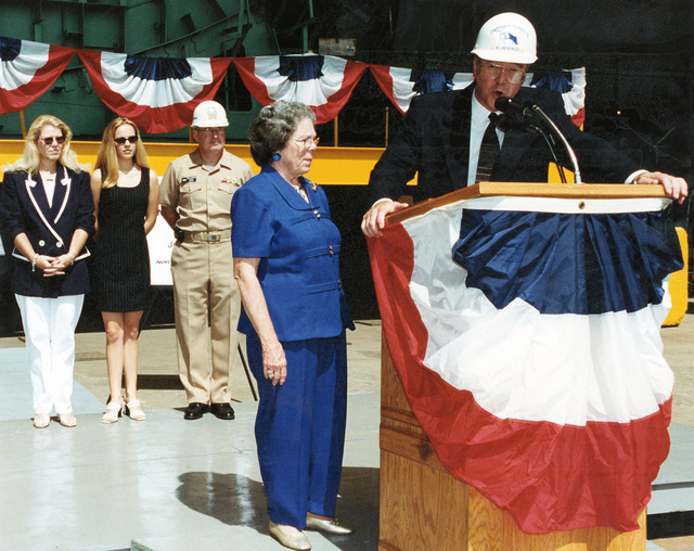 Mr. Robert L. Merchant (right), Vice President, Program Manager DDG 51 Program, Northrop Grumman Ship Systems, Ingalls Operations, introduces Mrs. Elaine Williams, Widow of the late US Navy (USN) PETTY Officer First Class (PO1) James E. Williams, during the Official Keel Laying Ceremony for the for the US Navy (USN) ARLEIGH BURKE CLASS (FLIGHT IIA) GUIDED MISSILE DESTROYER (AEGIS) USS JAMES E. WILLIAMS (DDG 95). Pictured in the background left-to-right Mrs. Gail Patterson, daughter of ship's namesake; Miss Danielle Patterson, granddaughter of ship's namesake; and USN Captain (CPT) Phil Johnson, Supervisor of Shipbuilding, Conversion and Repair, Pascagoula, Mississippi (MS)