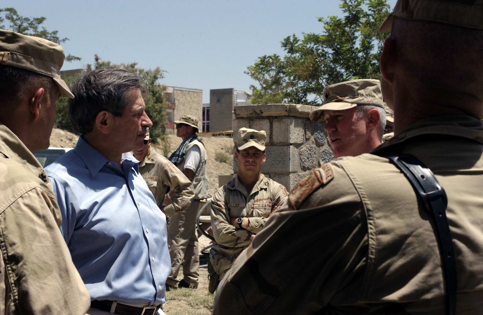 US Deputy Secretary of Defense, The Honorable Paul Wolfowitz (center), talks with US Army (USA) Brigadier General (BGEN) John H. Kern, Commander, 352nd Civil Affairs Command (CFC), during is official visit to Kabul, Afghanistan
