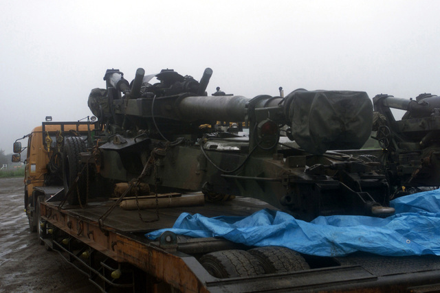 An M198 155mm Medium Howitzer loaded onto a Japanese contractor flatbed truck for movement to the Ojojihara Maneuvering Area. The M198 will be used by Marines from 5th Battalion 10th Marine Regiment on a Unit Deployment Program [UDP] to 3d Battalion 12th Marine Regiment for the OJOJIHARA ARTILLERY LIVE FIRE Exercise in Ojojihara, Japan