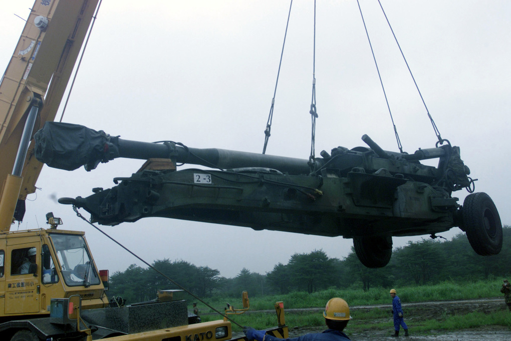 Japanese contractors use a Kato KR35-3 35-ton crane to unload the M198 155mm Medium Howitzer. The M198 will be used by Marines from 5th Battalion 10th Marine Regiment on a Unit Deployment Program [UDP] to 3d Battalion 12th Marine Regiment for the OJOJIHARA ARTILLERY LIVE FIRE Exercise in Ojojihara, Japan