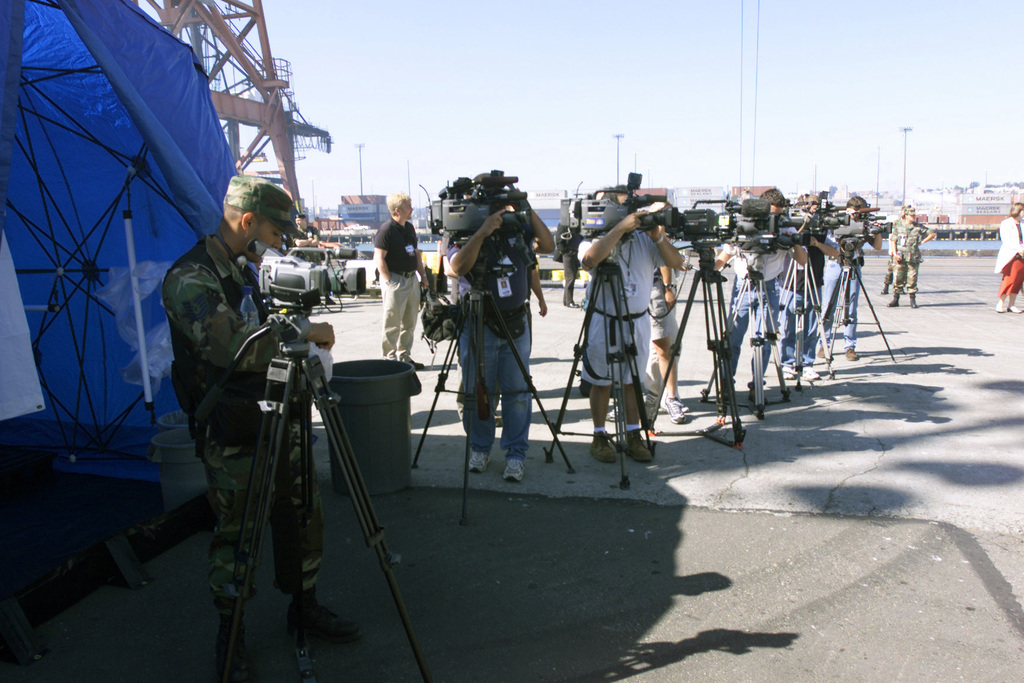 US Air Force (USAF) Technical Sergeant (TSGT) Mario Muncey (foreground), a Videographer assigned to the 4th Combat Camera Squadron (CCS) sets up his camera with other members of the local civilian news media to document activities prior to the start of Exercise SEAHAWK 2002, at McChord Air Force Base (AFB), Washgton, (WA). Seahawk combes active duty and reserve components from the US Air Force (USAF), US Navy (USN), US Coast Guard (USCG), US Public Health Service, Royal Canadian Armed Forces (RCAF), Federal Bureau of Investigation (FBI), Federal Emergence Management Association (FEMA) and multiple civilian first responder agencies coordated responses to simulated terrorist acts...