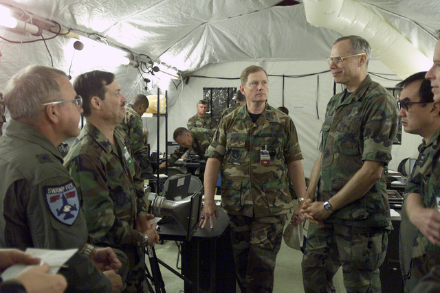 US Air Force (USAF) Brigadier General (BGEN) Joseph E. Kelley (4th from left), Assistant Surgeon General of Expeditionary Operations, Science and Technology visits with Command personnel from the Expeditionary Medical System (EMEDS) hospital at Fort Lewis, Washington (WA), during Exercise SEAHAWK 2002. Seahawk combines active duty and reserve components from the US Air Force (USAF), US Navy (USN), US Coast Guard (USCG), US Public Health Service, Royal Canadian Armed Forces (RCAF), Federal Bureau of Investigation (FBI), Federal Emergence Management Association (FEMA) and multiple civilian first responder agencies in coordinated responses to simulated terrorist acts inside the Continental...