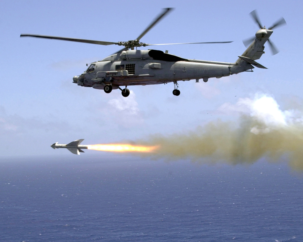 """A US Navy (USN) SH-60B """"Seahawk"""" LAMPS III helicopter from Helicopter Anti-Submarine Squadron Light Five One (HSL-51), fires an AGM-119B """"Penguin"""" Anti-Ship Missile during aircrew weapon certifications"""