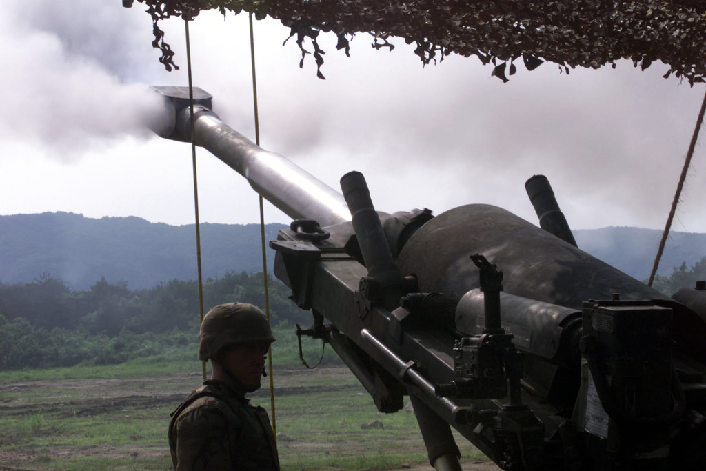 Marines from 5th Battalion 10th Marine Regiment on a Unit Deployment Program [UDP] to 3d Battalion 12th Marine Regiment fire the M198 155mm Medium Howitzer during the OJOJIHARA ARTILLERY LIVE FIRE Exercise in Ojojihara, Japan