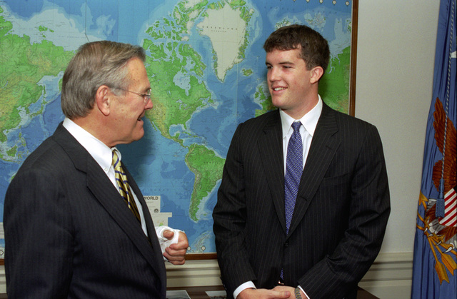 The Honorable Donald H. Rumsfeld (left), U.S. Secretary of Defense, meets with Charles Capiro, a SENIOR at Duke University and grandson of Arch Moore, former Governor of West Virginia, at the Pentagon, Washington, D.C., on Aug. 2, 2002.  OSD Package No. A07D-00591 (DOD PHOTO by Robert D. Ward) (Released)