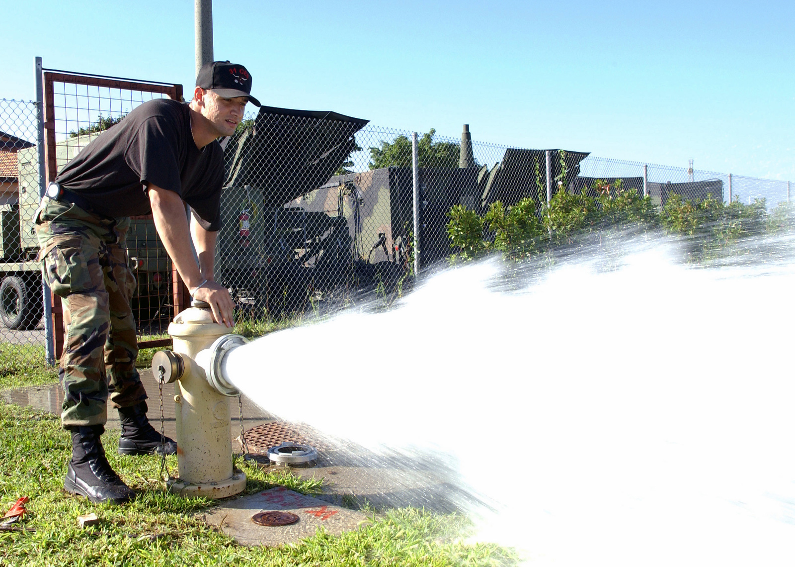 US Air Force (USAF) SENIOR AIRMAN (SRA) Anthony Constantine, 31st Civil Engineer Squadron (CES) releases water from a fire hydrant at Aviano Air Base (AB), Italy