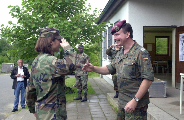 US Air Force (USAF) AIRMAN First Class (A1C) Pam Jackson assigned to 886th Communication Squadron (CS), Sembach Annex, Germany, earns the German shooting medal, the Shutzensnur, a medal worn only by the best marksmen in the German Military