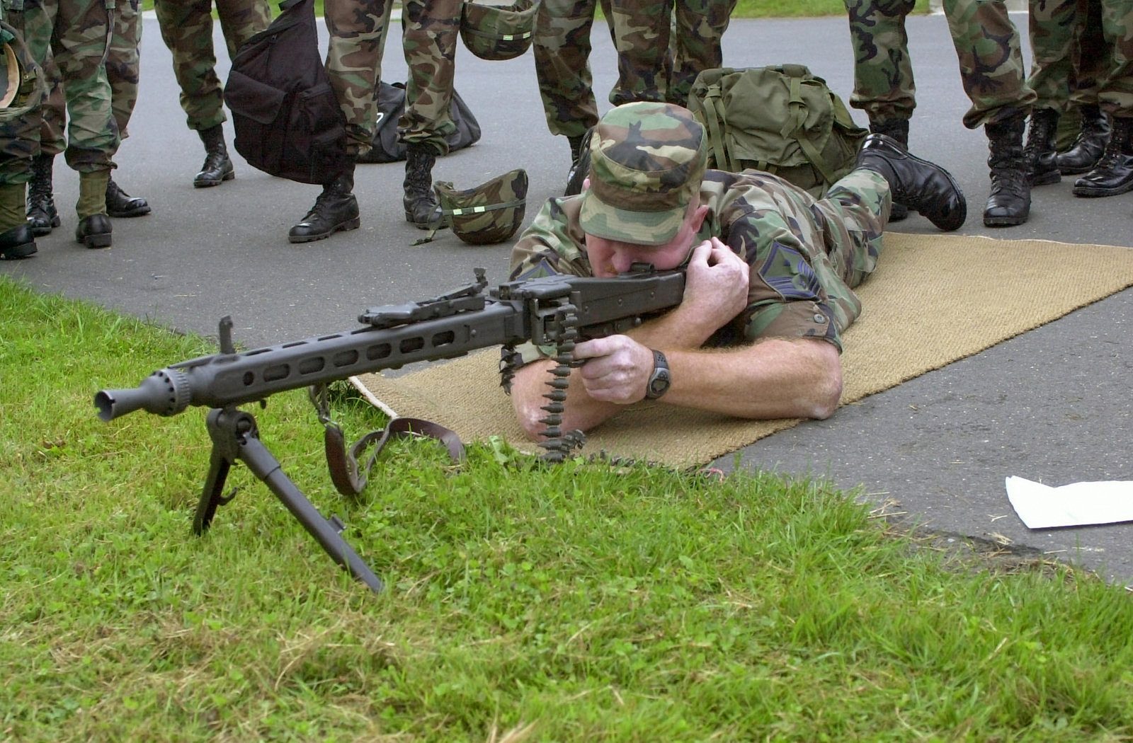 US Air Force (USAF) MASTER Sergeant (MSGT) Russell Harrington, First Sergeant (1SGT) of the 886th Communication Squadron (CS), Sembach Annex, Germany, receives hands on training with a German MG42 7.92mm machine gun, the equivalent of our M-60 7.62mm machine gun