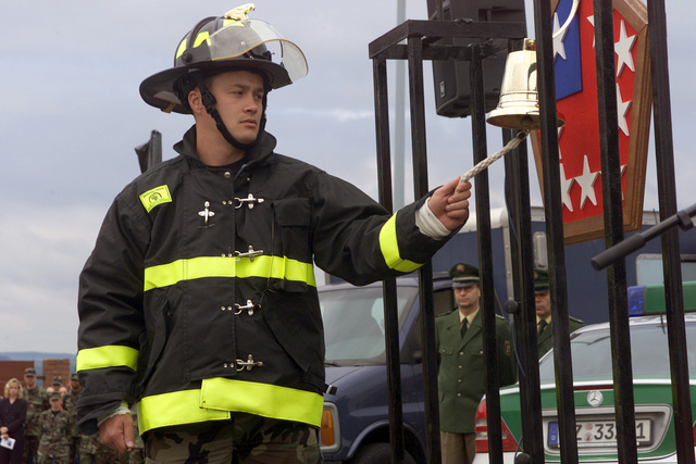 US Air Force (USAF) STAFF Sergeant (SSGT) Lee Manley, 5th Civil Engineering Squadron (CES), rings the final alarm during the Remembrance Ceremony on Patriots Day, at Spangdahlem Air Base (AB), Germany