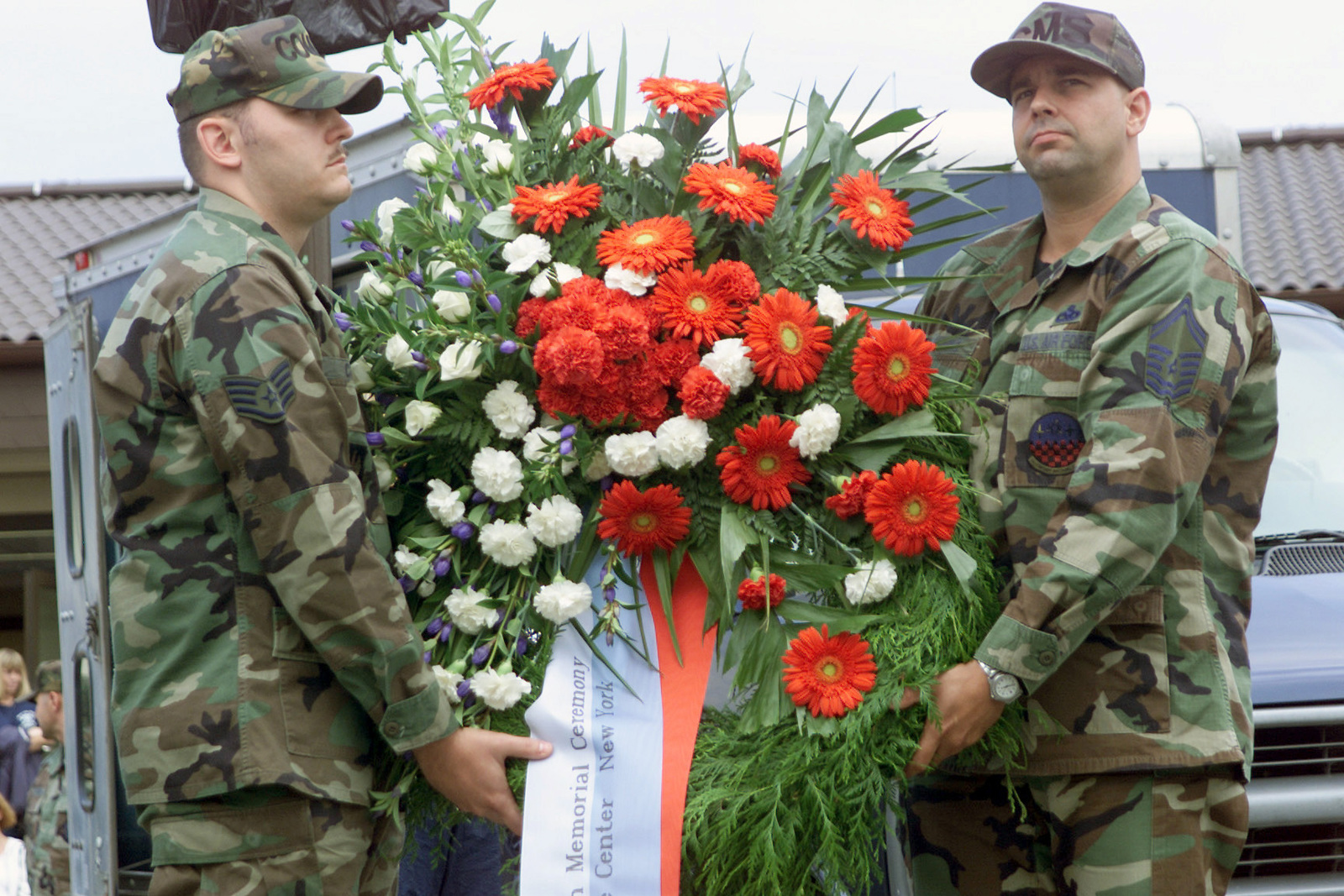 US Air Force (USAF) STAFF Sergeant (SSGT) Leon Cook, left and SENIOR MASTER Sergeant (SMSGT) Robert Cushing lay a wreath to honor the lives lost on September 11th, 2001, during Spangdahlem's Remembrance Ceremony on Patriots Day, at Spangdahlem Air Base (AB), Germany
