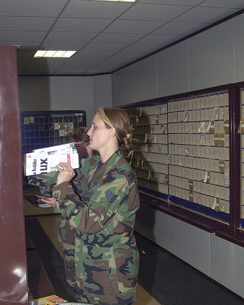 US Air Force Reserve (USAFR) STAFF Sergeant (SSGT) Davis, 910th Communications Flight, sorts mail into boxes while deployed with the 31st Communication Squadron (CS), at Aviano Air Base (AB), Italy, for her two-week annual tour