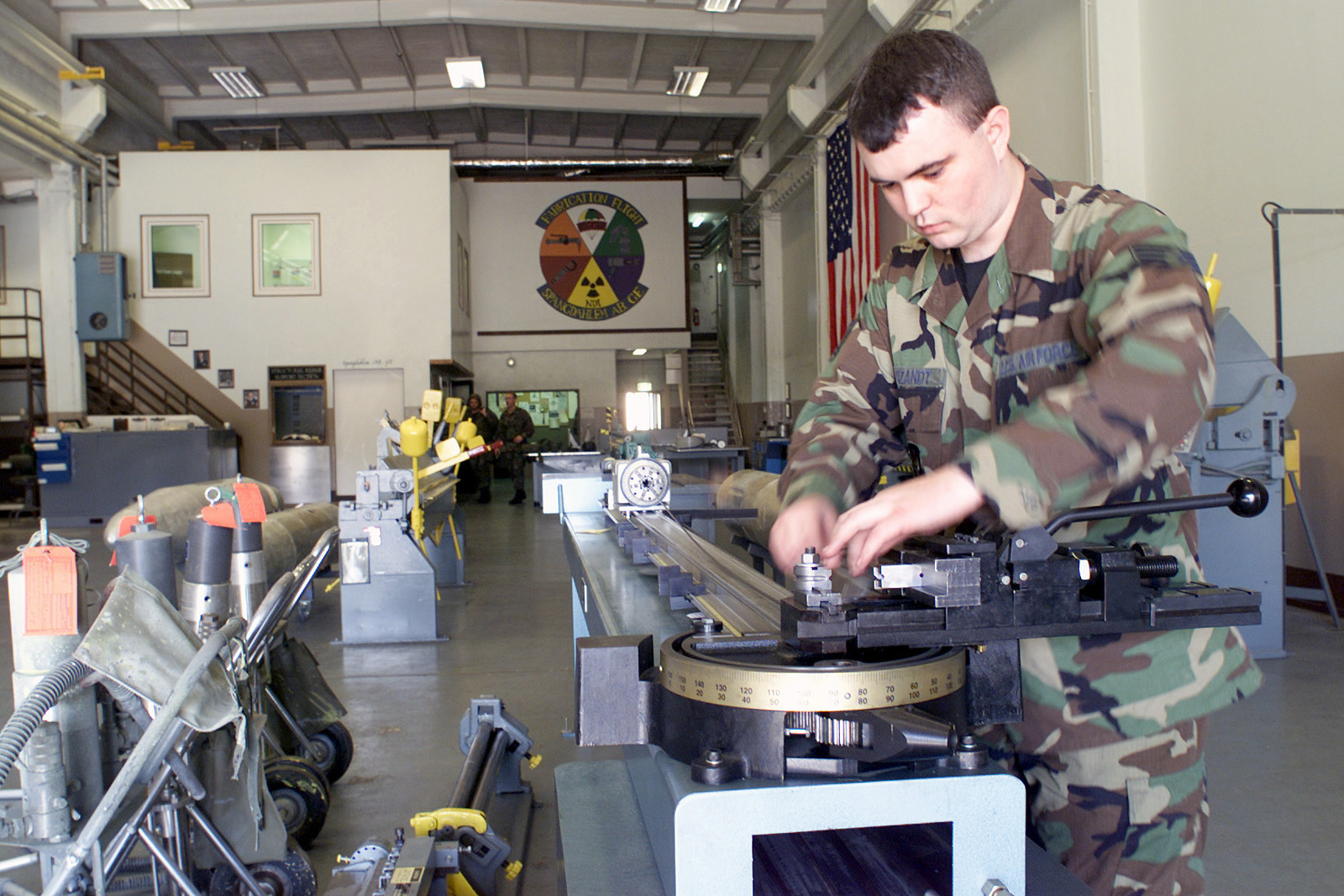US Air Force (USAF) SENIOR AIRMAN (SRA) Chris Vanzandt, Aircraft Structures Journeyman, 52nd Equipment Maintenance Squadron (EMS), uses metal tubing to create an aircraft drain line inside the maintenance shop at Spangdahlem Air Base (AB), Germany