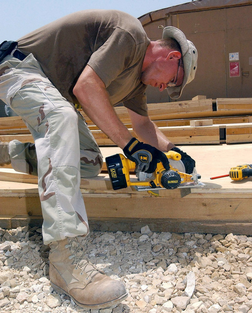 US Air Force (USAF) STAFF Sergeant (SSGT) Richard Panepinto, Structural Craftsman, 438th Expeditionary Civil Engineering Flight (ECEF), work to construct handrails for a new patio addition to the Base Chapel, while deployed at a forward location supporting Operation ENDURING FREEDOM