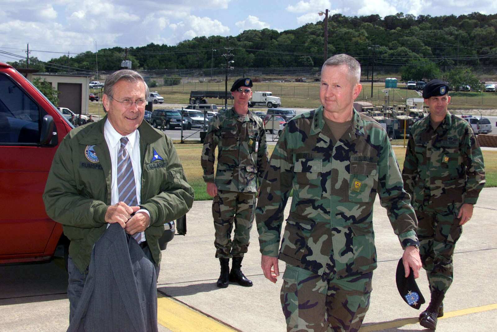 U.S. Army LT. Gen. Burwell B. Bell (front, right), Commander, III Corps and Fort Hood, escorts The Honorable Donald H. Rumsfeld (left), U.S. Secretary of Defense, to his airplane at Fort Hood's Robert Gray Army Airfield after the Secretary's Town Hall Meeting in Howze Theater, Fort Hood, Texas, on Aug. 21, 2002. (U.S. Army photo by Christopher J. Varville) (Released)