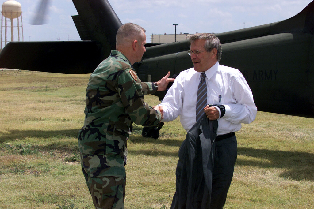 U.S. Army LT. Gen. Burwell B. Bell (left), Commander, III Corps and Fort Hood, greets the Honorable Donald H. Rumsfeld (right), U.S. Secretary of Defense, upon his arrival at Fort Hood, Texas, on Aug. 21, 2002, to conduct a town Hall Meeting in Howze Theater. (U.S. Army photo by Christopher J. Varville) (Released)