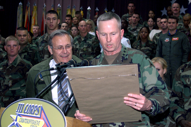 U.S. Army LT. Gen. Burwell B. Bell (right), Commander, III Corps and Fort Hood, presents the Honorable Donald H. Rumsfeld (left), U.S. Secretary of Defense, with certificate proclaiming the Secretary an honorary member of the Phantom Corps at the end of the Secretary's Town Hall Meeting in Howze Theater, Fort Hood, TX, on Aug. 21, 2002. (U.S. Army photo by Christopher J. Varville, CIV) (Released)