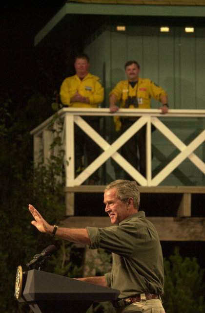President George Bush appearing at the Jackson County Fairgrounds, Central Point, Oregon, for address on the Healthy Forests Initiative and environmental policy, following his visit to the site of the Squire Peak forest fire. Photograph was selected for use in Department of Interior video on the tenure ofSecretary Gale Norton