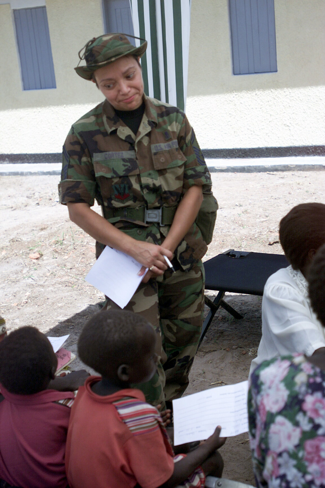 US Air Force (USAF) Major (MAJ) Brenda Owen assigned to the 52nd Medical Group, Spangdahlem Air Base (AB), Germany, triages patients in support of MEDFLAG 2002